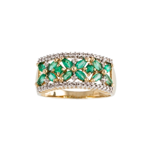 5 - AN EMERALD AND DIAMOND DRESS RING, the marquise cut emeralds arranged in three clusters within a dia...