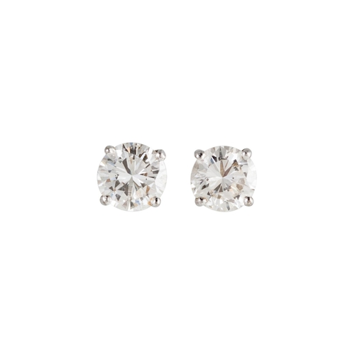 51 - A PAIR OF DIAMOND STUD EARRINGS, the brilliant cut diamonds mounted in yellow gold. Estimated; weigh...