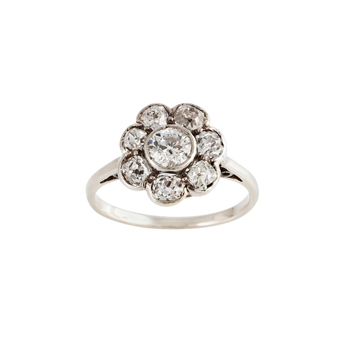 7 - AN ANTIQUE DIAMOND 'DAISY' CLUSTER RING, set with old cut diamonds, mounted in white gold. Estimated...