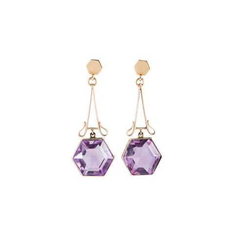 8 - A PAIR OF AMETHYST DROP EARRINGS, the hexagonal amethysts suspended from shaped openwork panels, yel...