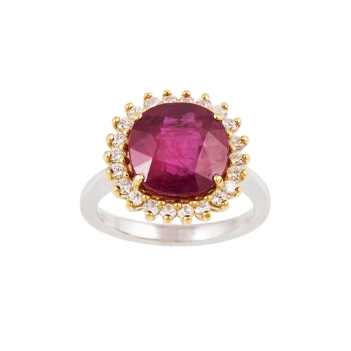 1 - A RUBY AND DIAMOND CLUSTER RING, the circular ruby to a brilliant cut diamond surround, mounted in 1...