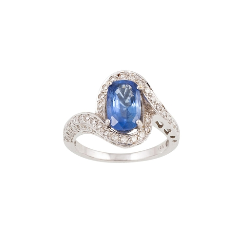 10 - A DIAMOND AND SAPPHIRE CLUSTER RING, of twist design, the oval sapphire to diamond surround and shou...