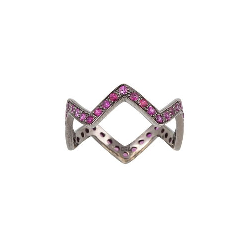 11 - A RUBY ETERNITY RING, of angular form, mounted in 18ct gold. Estimated; weight of rubies; 1.30 ct, s...