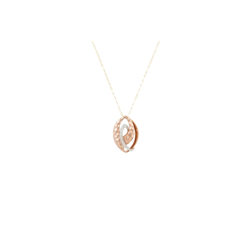 13 - A DIAMOND SET PENDANT, the shaped panel in knot form, mounted in 9ct gold, on a gold chain...