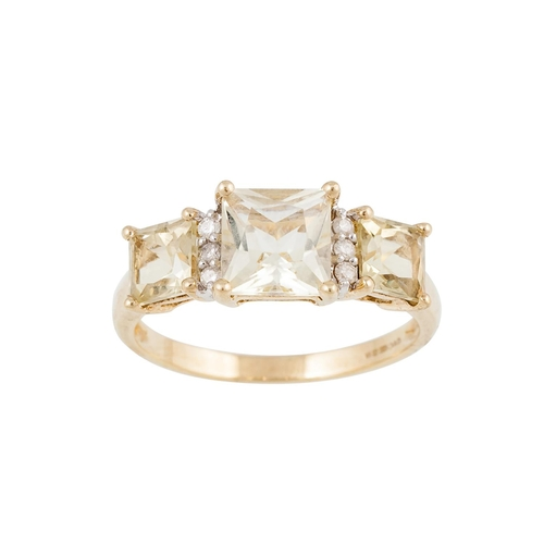 15 - A DIAMOND AND YELLOW TOPAZ RING, the square topaz set between diamonds, mounted in 9ct yellow gold, ...
