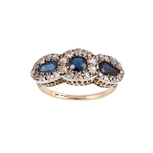 17 - AN ANTIQUE DIAMOND AND SAPPHIRE TRIPLE CLUSTER RING, mounted in 18ct gold. Estimated; weight of diam...