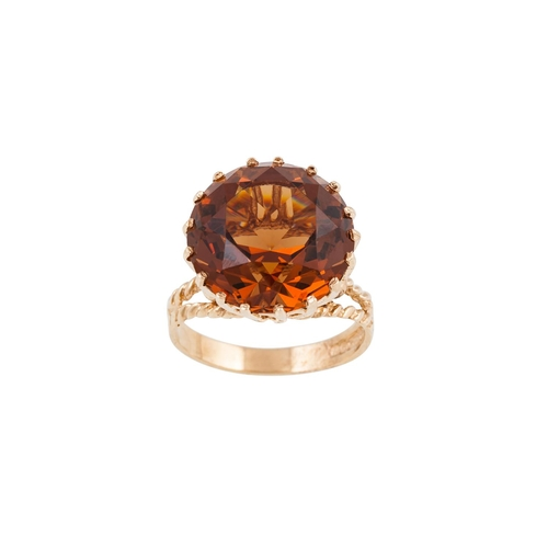 20 - A TOPAZ DRESS RING, set with a large oval topaz, mounted in 9ct gold, size O....