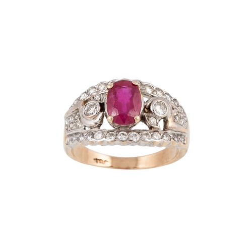 25 - A DIAMOND AND RUBY CLUSTER RING, of oval form, mounted in 18ct yellow gold. Estimated; weight of dia...