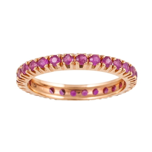 4 - A RUBY ETERNITY RING, mounted in yellow gold. Estimated; weight of rubies; 0.25 ct, size O...
