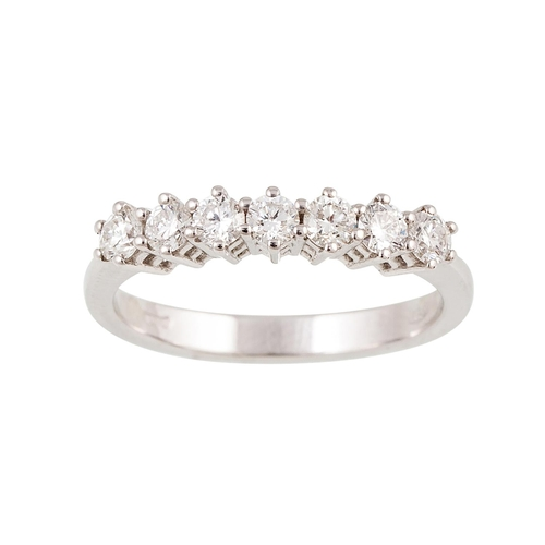 40 - A SEVEN STONE DIAMOND RING, the brilliant cut diamonds mounted in 18ct white gold. Estimated; weight...