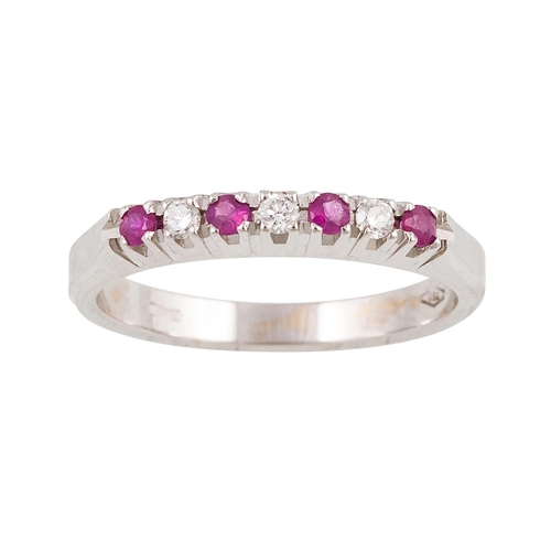 41 - A SEVEN STONE RUBY AND DIAMOND RING, the circular stones mounted in 18ct white gold. Estimated; weig...