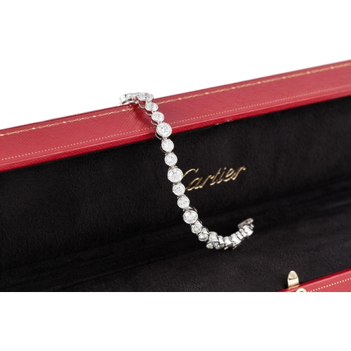 426 - A DIAMOND BRACELET BY CARTIER, the collet set diamonds mounted in platinum and white gold, signed Ca...