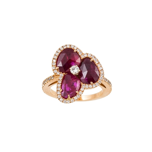 43 - A RUBY AND DIAMOND CLUSTER RING, of floral design, the oval rubies to a diamond surround and shoulde...
