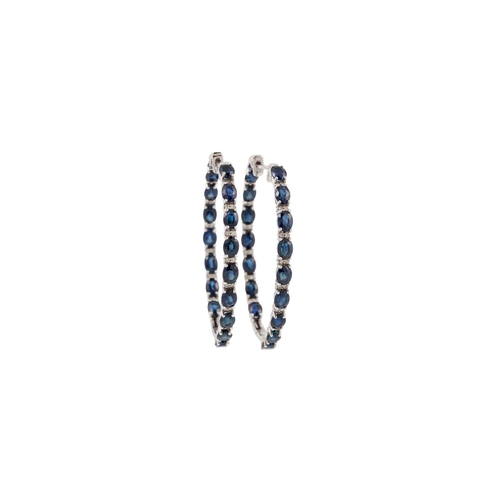 47 - A PAIR OF DIAMOND AND SAPPHIRE HOOP EARRINGS, the oval sapphires interspersed with brilliant cut dia...