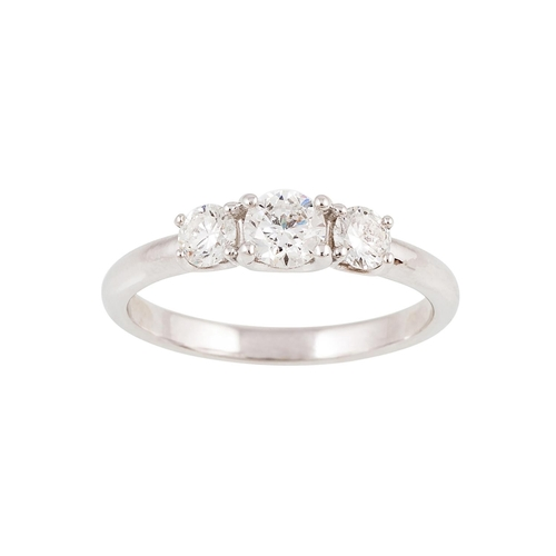 5 - A THREE STONE DIAMOND RING, the brilliant cut diamonds mounted in 18ct gold. Estimated; weight of  d...