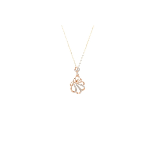 51 - A DIAMOND SET PENDANT, the shaped panel set with diamonds, mounted in 9ct gold, on a chain...