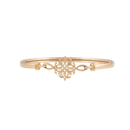 59 - A 9CT GOLD BANGLE, with a shaped centre panel...