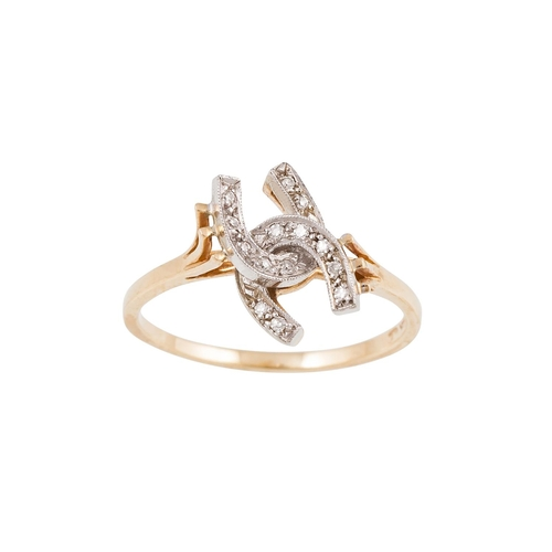 60 - A DIAMOND SET RING, modelled as two entwined horseshoes, mounted in 9ct gold, size O...