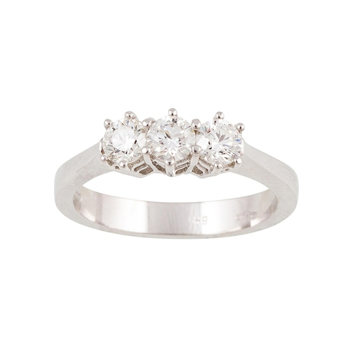 7 - A THREE STONE DIAMOND RING, the brilliant cut diamonds mounted in 18ct white gold. Estimated; weight...