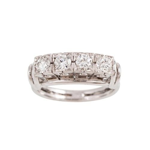 10 - A VINTAGE DIAMOND FOUR STONE RING, the brilliant cut diamonds mounted in 18ct white gold, carved mou...
