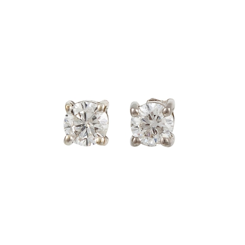 11 - A PAIR OF DIAMOND STUD EARRINGS, the brilliant cut diamonds mounted in white gold. Estimated; weight...
