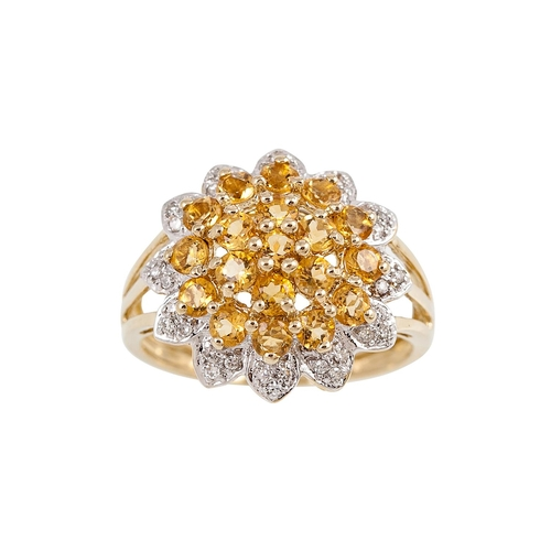 15 - A DIAMOND AND CITRINE CLUSTER RING, the central citrine cluster to a diamond border, mounted in 9ct ...