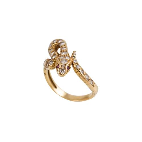 185 - A VINTAGE DIAMOND SET SNAKE RING, set with brilliant cut diamonds, ruby eyes, 18ct yellow gold mount...