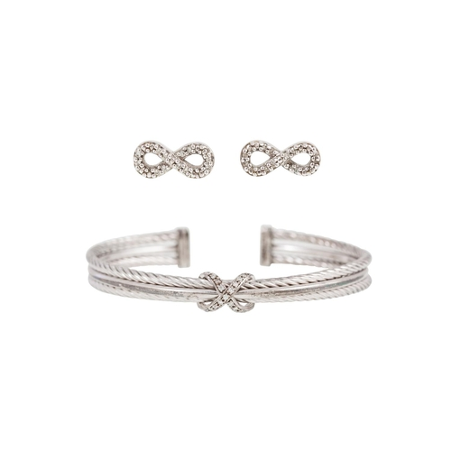 255 - A CONTEMPORARY STERLING SILVER BANGLE, with diamond detail, together with a similar pair of stone se...