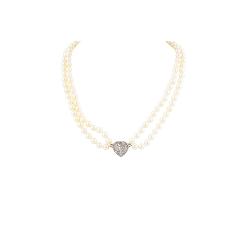 278 - A PEARL NECKLACE, central heart shaped panel pavé set with old cut diamonds. Estimated; weight of di...