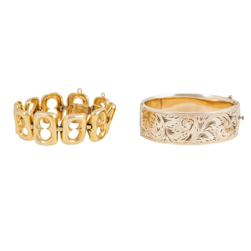 28 - A COLLECTION OF VINTAGE GOLD PLATED JEWELLERY, including an engraved bangle, a muff chain, a necklac...