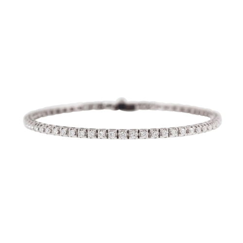 34 - A DIAMOND LINE BRACELET, the brilliant cut diamonds mounted in 18ct white gold. Estimated; weight of...