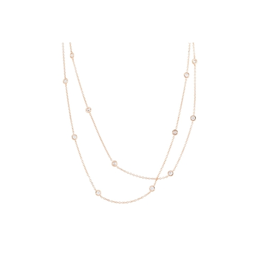 36 - A DIAMOND SET CHAIN, the collet set diamonds linked by chain, mounted in 18ct rose gold. Estimated; ...