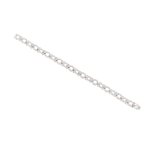 40 - A DIAMOND BRACELET, comprising alternate oval and rectangular links, set with diamonds, mounted in 1...