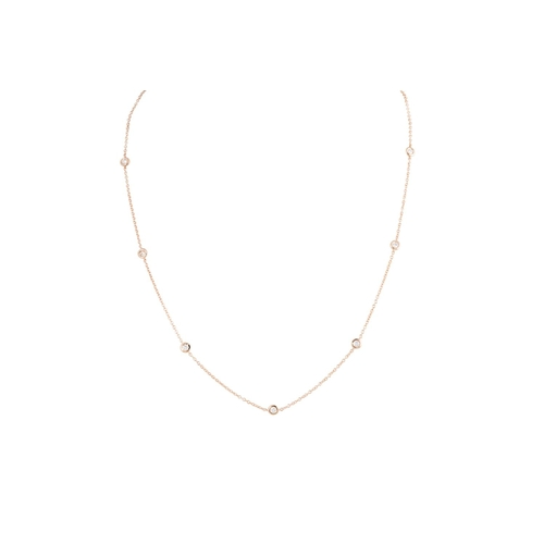 48 - A DIAMOND SET CHAIN, the collet set diamonds linked by chain, mounted in 18ct rose gold. Estimated; ...