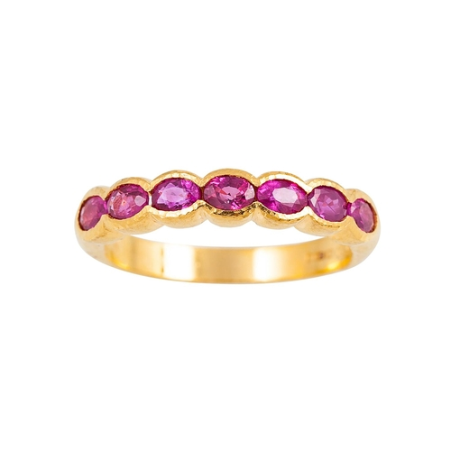 51 - A DIAMOND AND RUBY HALF ETERNITY RING, the oval rubies mounted in 18ct yellow gold, size P - Q