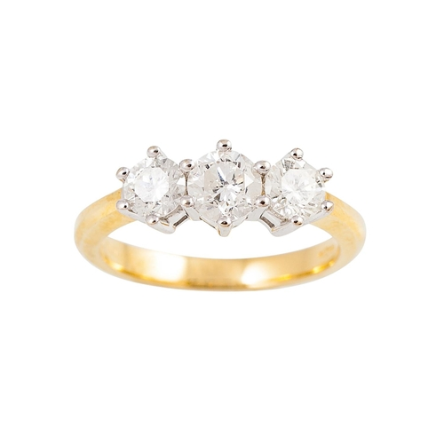 59 - A THREE STONE DIAMOND RING, the brilliant cut diamonds mounted in 18ct yellow gold. Estimated; weigh...
