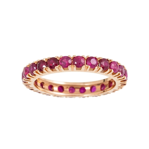 78 - A RUBY ETERNITY RING, set with circular stones, mounted in 18ct yellow gold. Estimated; weight of ru...
