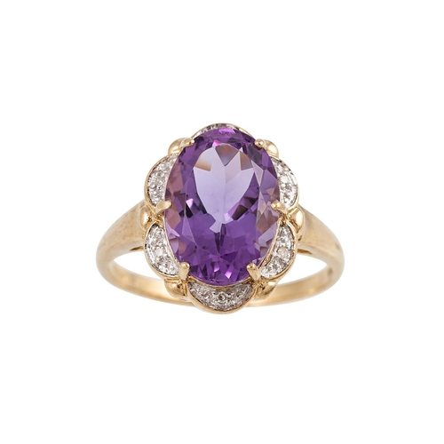 8 - A DIAMOND AND AMETHYST CLUSTER RING, the oval amethyst to diamond points, mounted in 9ct yellow gold...