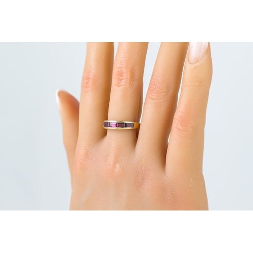 3 - A PINK TOURMALINE HALF ETERNITY RING, channel set in 9ct gold, size Q
