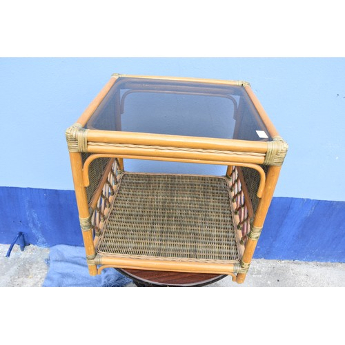 20 - A SQUARE WICKER TABLE WITH GLASS TOP