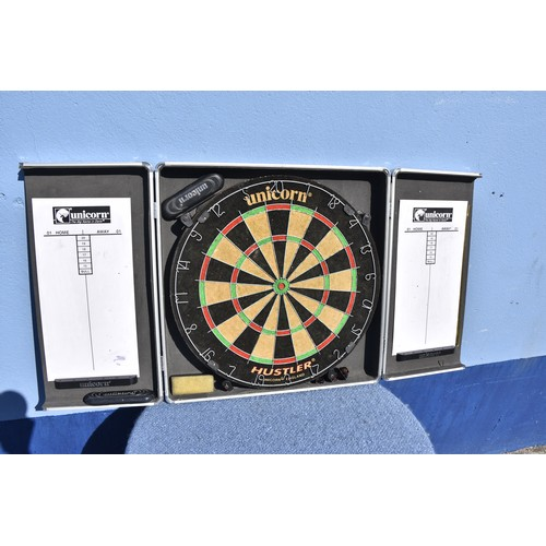 134 - A DARTBOARD IN ITS CASE