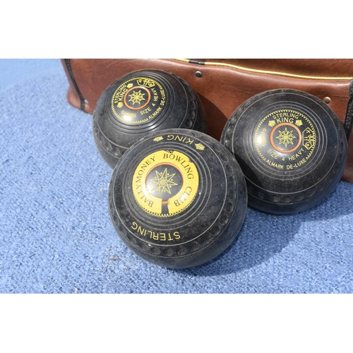 145 - QTY OF LAWN BOWLS AND BAG