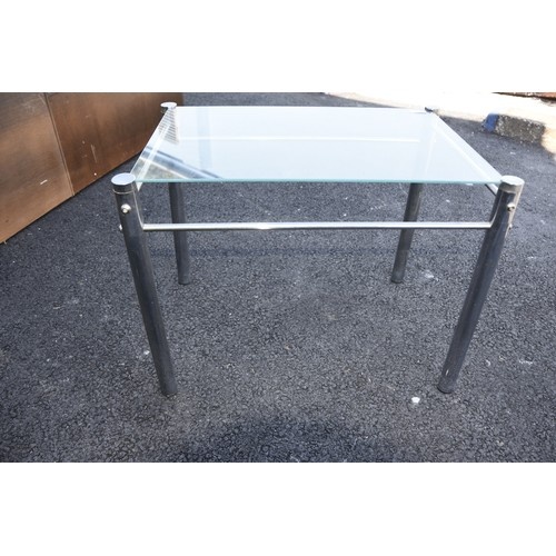 149 - A CHROME AND GLASS LAMP TABLE