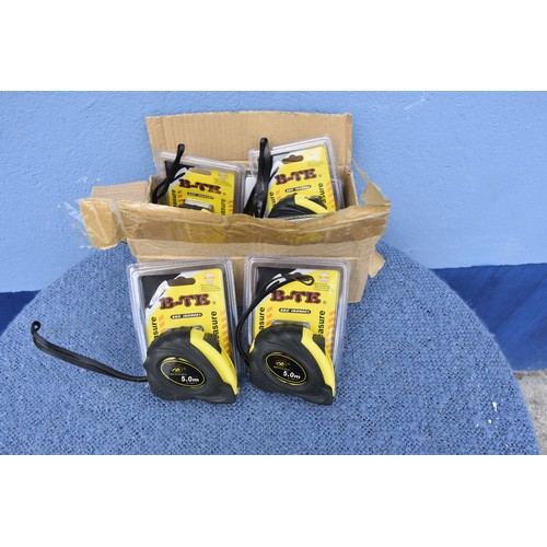 43 - A BOX OF NEW MEASURING TAPES