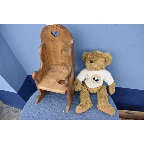 331 - A TEDDY BEAR IN A ROCKING CHAIR