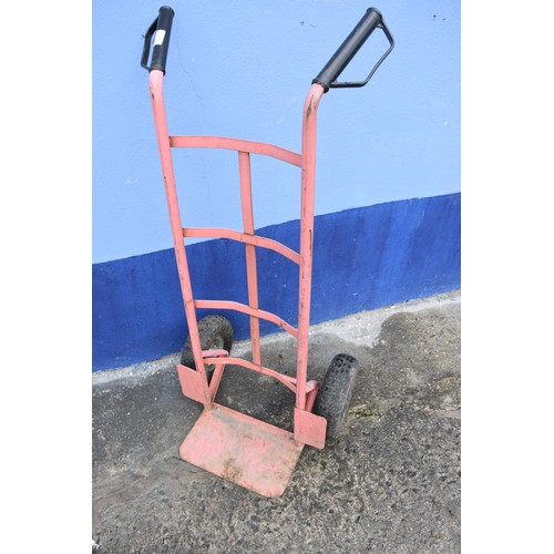 336 - A RED SACK TROLLEY