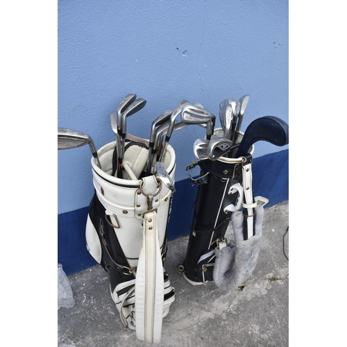 355 - 2 GOLF BAGS AND CLUBS
