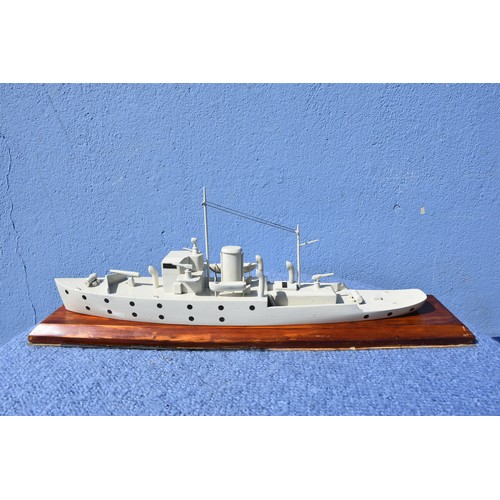453 - A MODEL SHIP ON PLINTH