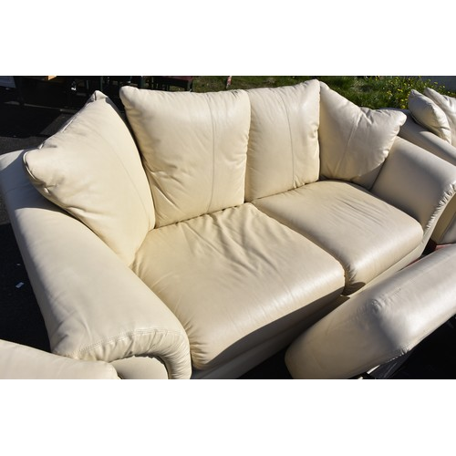 486 - A CREAM LEATHER 3 PIECE SUITE WITH A MATCHING POUFEE