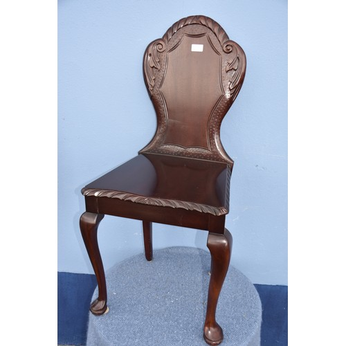 490 - A MAHOGANY HALL CHAIR WITH SHIELD BACK
